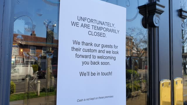 sign on the window of the crown and greyhound pub displays its closed during the coronavirus pandemic on march 23, 2020 in dulwich village, london,... - pub stock videos & royalty-free footage