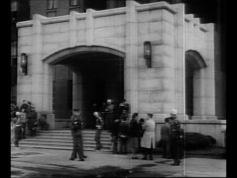 """stockvideo's en b-roll-footage met sign outside building """"international military tribunal far east"""" / ext war ministry building in tokyo, where tribunal is to be held for japanese war... - mp"""