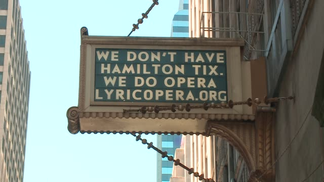 """sign outside chicago's lyric opera reads, """"we don't have hamilton tix"""" on june 21, 2016--the day tickets to hamilton, the musical, at private bank... - hamilton new york state stock videos & royalty-free footage"""