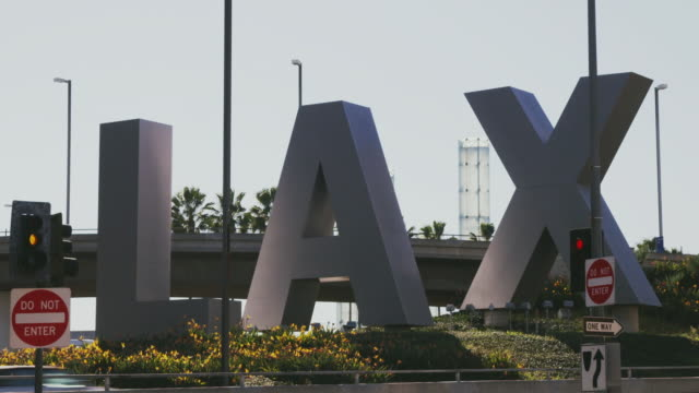 ms lax sign outside of airport, los angeles, california, usa - lax airport stock videos & royalty-free footage