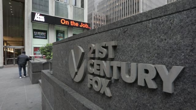 a sign outside the 21st century fox headquarters in new york wednesday may 3 2017 shots low angle wide shot of 21st century fox generic shots up... - headquarters stock videos & royalty-free footage