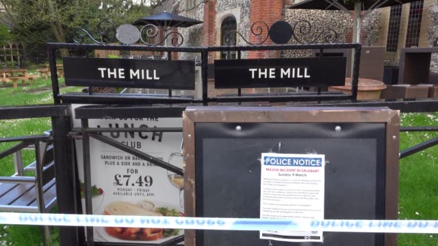 a sign outside the mill restaurant and pub is seen as members of the military work in the maltings shopping area close to the bench where russian... - 週点の映像素材/bロール