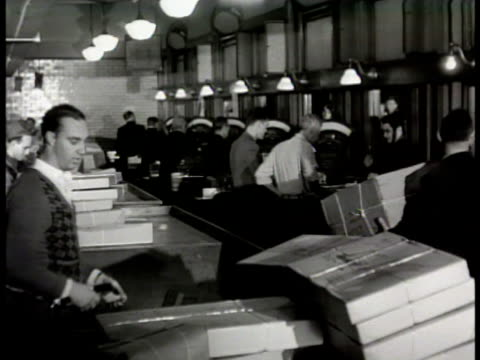 sign 'parcel post' int ls postal workers sorting boxes in parcel room ms clerk stamping box from customer at window vs weighing parcel on scale... - window box stock videos & royalty-free footage