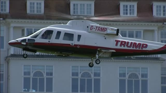 sign petition calling for donald trump to be banned from britain; lib scotland: ayrshire: turnberry: ext 'trump' helicopter landing at golf course... - petition stock videos & royalty-free footage