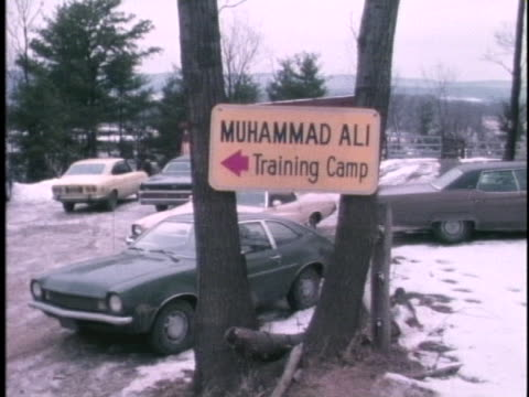 sign points the way to boxer muhammad ali's training camp. - 1974 stock videos & royalty-free footage