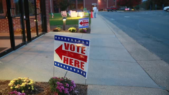 vídeos de stock, filmes e b-roll de a sign points voters to the polling site at sherwood oaks christian church in bloomington indiana on election day 2016 the contentious and historic... - bloomington indiana