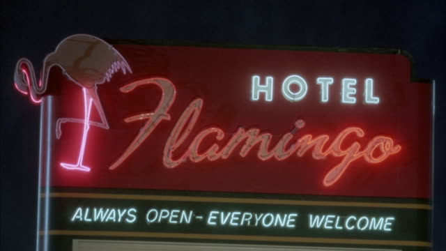 a sign promotes the location of the hotel flamingo in las vegas, nevada. - blinking stock videos and b-roll footage