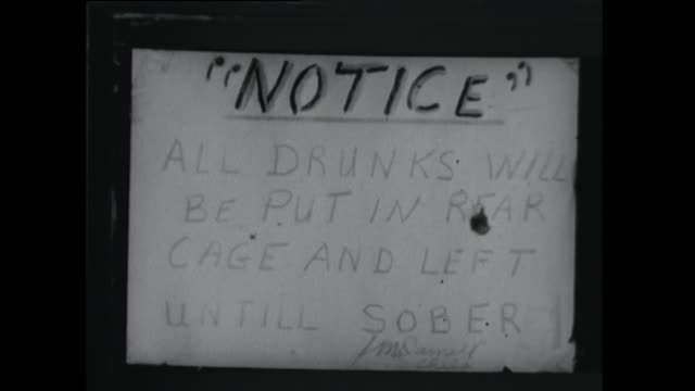 sign reading: drunks will be put in rear cage and left until sober - 1961 stock videos & royalty-free footage