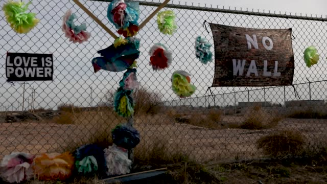 sign reading 'no wall' adorns the fence near where the tent encampment for migrant children was built at the tornillo-guadalupe port of entry on... - government shutdown stock videos & royalty-free footage