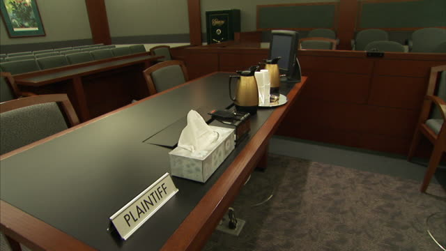 a sign reading plaintiff sits on a desk in a courtroom. - court room stock videos & royalty-free footage