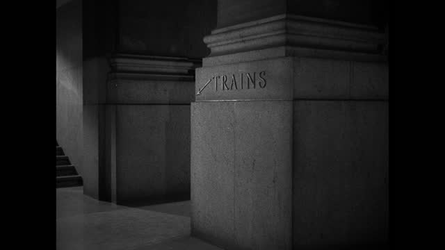 """a sign reading """"trains"""" marks a pillar in new york city's penn station. - new york city penn station stock videos & royalty-free footage"""