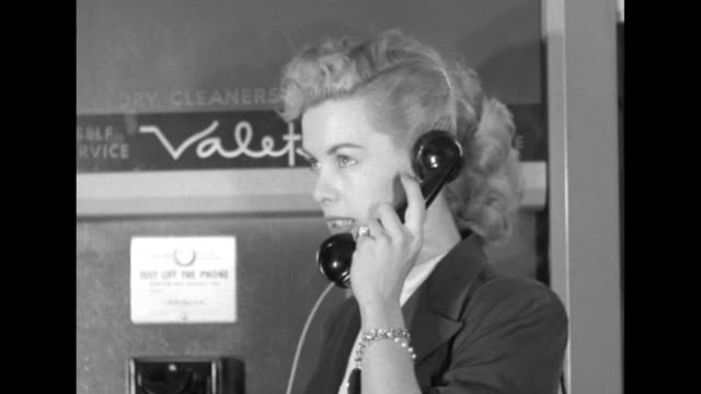 "sign reading ""valeteria"" on machine front above telephone; actress enters, picks up receiver and talks to male voice; pan down to include man's... - skådespelerska bildbanksvideor och videomaterial från bakom kulisserna"
