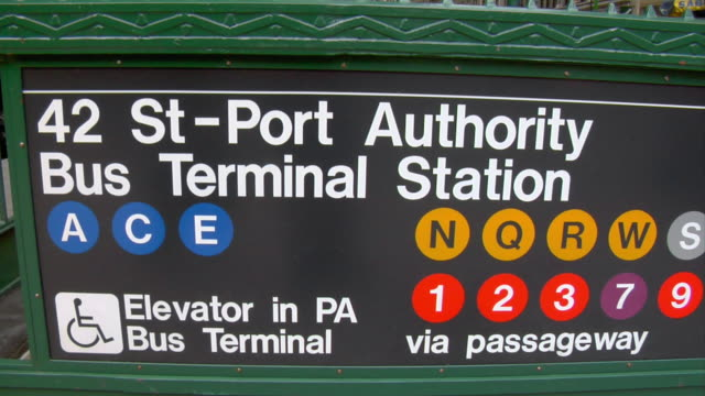 a sign reads 42nd street port authority bus terminal station. - port authority stock videos & royalty-free footage