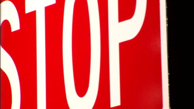"""vídeos de stock, filmes e b-roll de a sign reads """"stop"""". - sinal"""