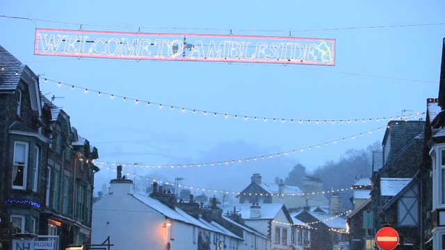 sign reads welcome to ambleside snow over ambleside in the lake district at christmas uk - decoration stock videos & royalty-free footage