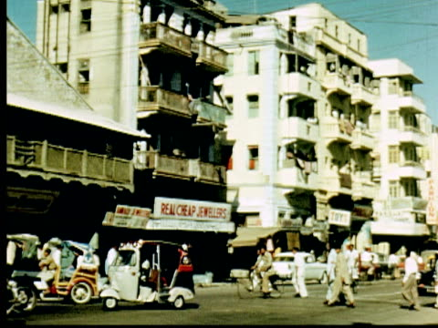 1960 montage sign: real cheap jewelry. busy city street in karachi with traffic, bicycles, shops / karachi, pakistan - sindh pakistan stock videos and b-roll footage