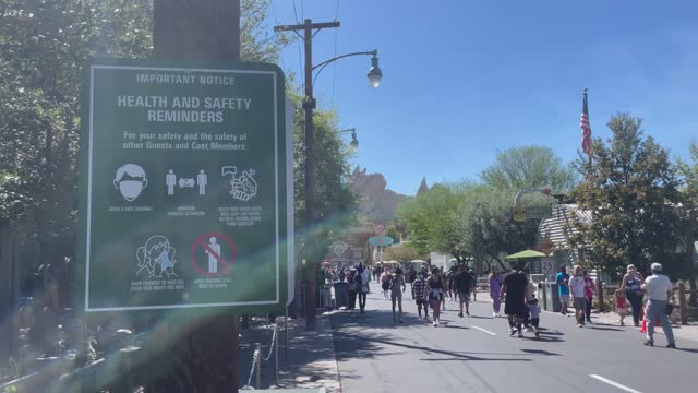 sign reminds visitors of social distancing rules as people arrive to visit disneyland and disney's california adventure reopen with social distancing... - adventure stock videos & royalty-free footage