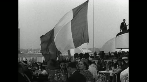 sign 'republique francaise.' french flag outdoor restaurant. court of nations building. vs court of peace w/ flags. tourists flushing meadows. - new york world's fair stock videos & royalty-free footage