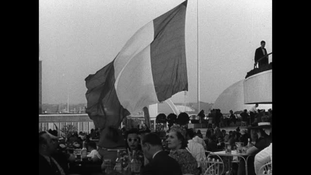 sign 'republique francaise.' french flag outdoor restaurant. court of nations building. vs court of peace w/ flags. tourists flushing meadows. - 1939 stock videos & royalty-free footage