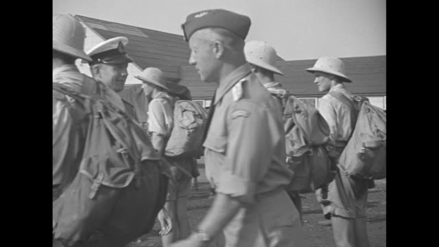 RNAF Training Camp Little Norway Lille Norge / Soldiers in summer uniforms of shorts and pith helmets marching past / An officer inspects his troops...