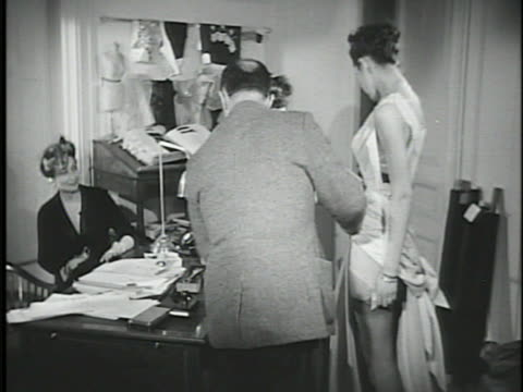 sign 'rond point des champs elysees' 'christian dior' signs designer christian dior in front of desk adjusting fabric on model vs models modeling... - 1957 stock videos & royalty-free footage