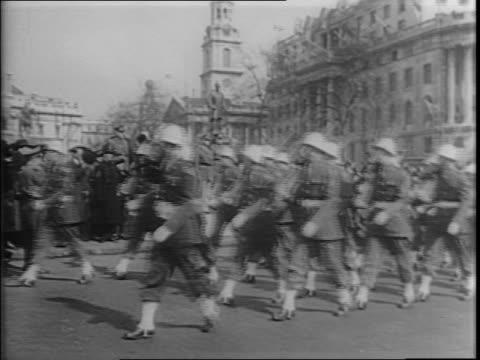 sign, 'salute the soldier' / montage of trafalgar square, american officers on horseback, army band marching, nelson's monument, aerial of trafalgar... - army soldier stock videos & royalty-free footage