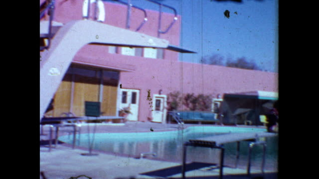 """sign """"sands a place in the sun"""" """"sammy davis jr. corbett monica""""; panning shot of pink hotel, cars parked in the parking lot; palm trees and swimming... - hotel stock videos & royalty-free footage"""