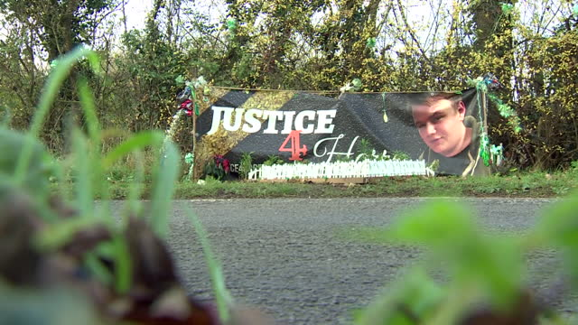a sign saying 'justice 4 harry' at the site where harry dunn was killed in a road accident by anne sacoolas - justice concept stock videos & royalty-free footage
