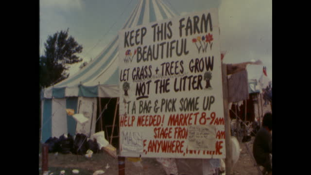 sign saying, keep this farm beautiful, pick up litter, at worthy farm at the 1985 glastonbury festival, pilton, somerset - 1984 stock videos & royalty-free footage