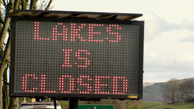 sign saying lakes is closed by the side of motorway leading into the lake district due to coronavirus lockdown - side view stock videos & royalty-free footage