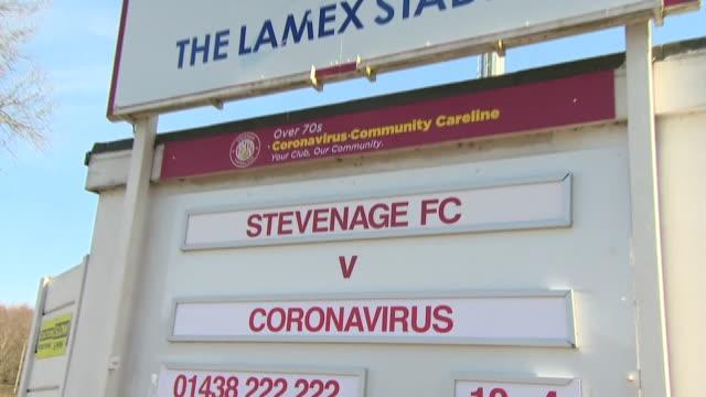 a sign saying 'stevenage fc v coronavirus' outside the club's lamex stadium - fitness stock videos & royalty-free footage