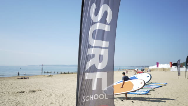 a sign saying surf on the beach. - bournemouth england stock videos & royalty-free footage