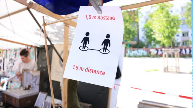 "sign says ""1,5 m distance"" at a flea market in the mauerpark in the district prenzlauer berg during the coronavirus crisis on august 23, 2020 in... - tourism stock videos & royalty-free footage"