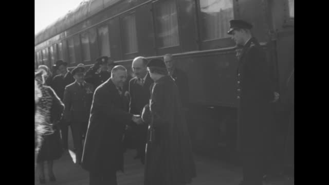 sign says fredericton / train arriving at station / people waiting on platform / princess elizabeth and duke of edinburgh disembark from train greets... - nova scotia stock videos and b-roll footage