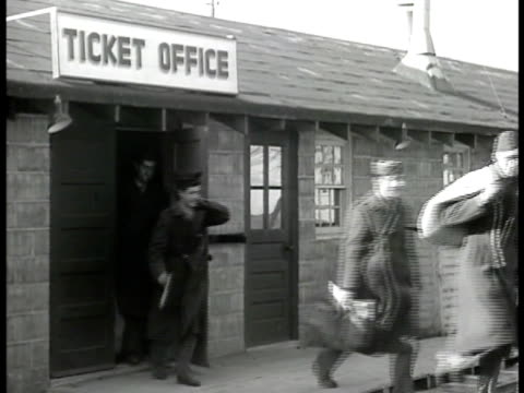 sign separation center soldiers in coats carrying duffle bags walking out of ticket office building door vs newspaper headlines related to housing... - 1946 stock videos and b-roll footage