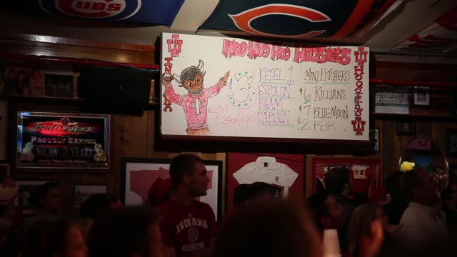 A sign shows a list of beers available as the Indiana University Hoosiers are playing basketball against against University of Kentucky during the...