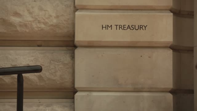 sign sits in a stone block outside the hm treasury building in london, u k, on monday, july 15 tourists, pedestrians and traffic pass the entrance of... - recreational horse riding stock videos & royalty-free footage