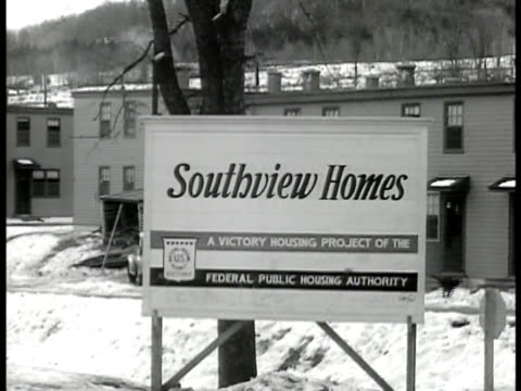 sign 'southview homes victory housing project of the federal housing authority' vs of simple houses built in cluster at bottom of hill snow on ground - 1946 stock videos and b-roll footage