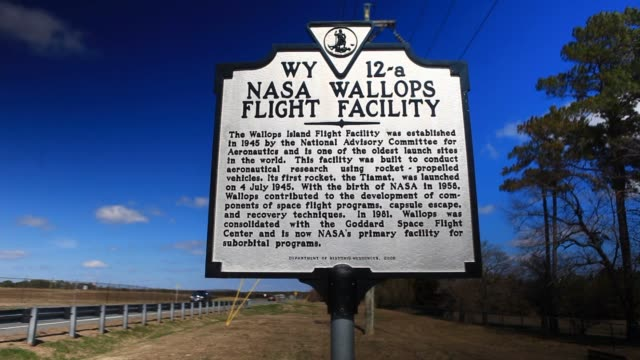 A sign stands near National Aeronautics and Space Administration Wallops Space Facility visitor center in Wallops Island Virginia US Various shots of...