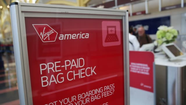 a sign stands near the virgin america inc checkin counter at ronald reagan national airport in washington dc us on monday april 4 2016 shots shot of... - ronald reagan washington national airport stock videos and b-roll footage