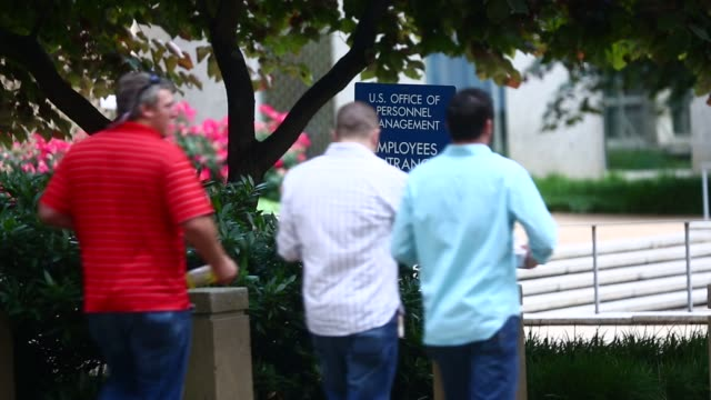 sign stands outside of the theodore roosevelt building, headquarters of the us office of personnel management , in washington, dc, us, on friday,... - bureaucracy stock videos & royalty-free footage