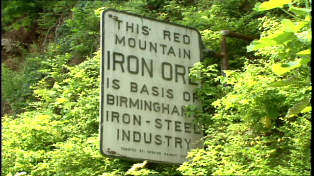 sign stating this red mountain iron ore is basis of birm iron steel industry in birmingham alabama - iron ore stock videos & royalty-free footage