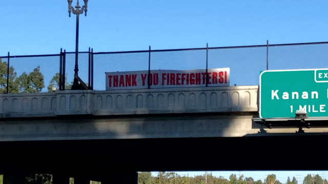 sign thank the firefighters hangs above the 101 freeway during the woolsey fire. - admiration stock videos & royalty-free footage