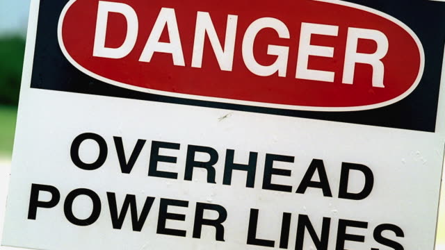 cu sign that reads 'danger overhead power lines' / georgetown, texas, usa - georgetown texas stock videos & royalty-free footage