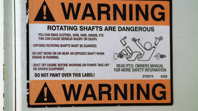 cu sign that reads 'warning rotating shafts are dangerous' / georgetown, texas, usa - georgetown texas stock videos & royalty-free footage