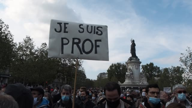"sign that says ""je suis prof"" is held as people gather in place de la république to pay tribute to professor samuel paty and to defend freedom of... - decapitated stock videos & royalty-free footage"