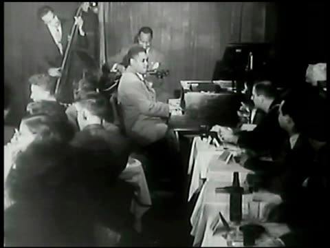 stockvideo's en b-roll-footage met sign 'three duces presents art tatum' int small club w/ jazz pianist art tatum jr playing piano sot cu tatum's fingers playing keyboard ms art tatum... - 1900 1909