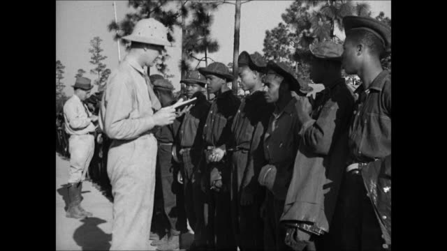 sign 'us ccc' vs africanamerican ccc workers lined up man w/ clipboard ws workers pushing wheel barrels w/ dirt labor work force dixie - civilian conservation corps stock-videos und b-roll-filmmaterial