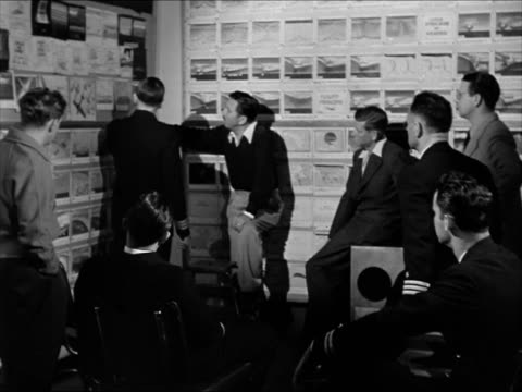 sign: 'walt disney productions'. int walt disney in room w/ us officers looking posted storyboards storyboards for instructional film illustrations... - producer stock videos & royalty-free footage