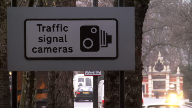 a sign warns drivers of traffic signal cameras. - warning sign stock videos & royalty-free footage